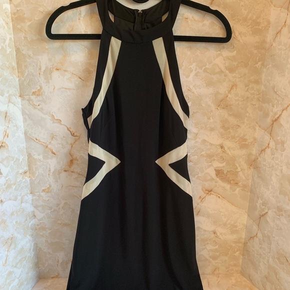 City Triangles Dresses & Skirts - City triangles black & cream dress. Size 7.